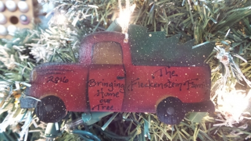"""TRUCK WITH TREE SAYING """"BRINGING HOME OUR TREE"""""""